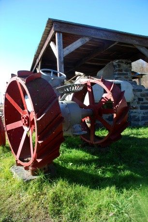 Antique tractor along 'chemin de roi' (Quebec)